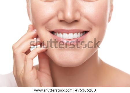 Beautiful smile of young woman. Closeup photo.