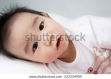 Beautiful smiling asian cute baby,Little boy sleep on bed
