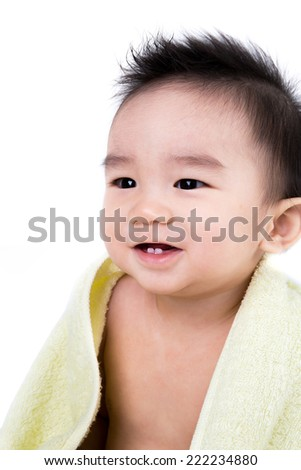 Beautiful smiling asian cute baby,Little boy with yellow  bath towel - stock photo