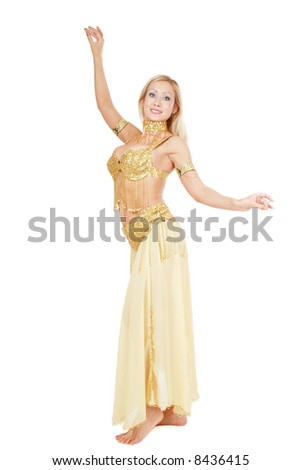 Beautiful smiling bellydancer posing in yellow-golden costume