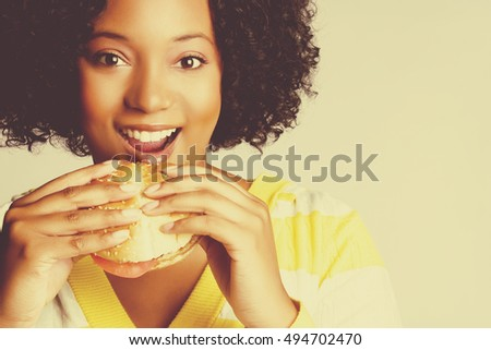 Beautiful smiling black woman eating food