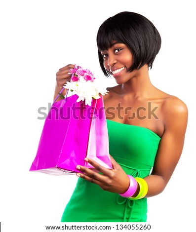 Beautiful smiling black woman with pink shopping bag isolated on white background, sale and money spending concept - stock photo