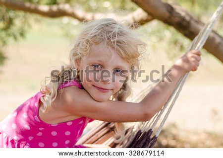 beautiful smiling blond little girl portrait - stock photo
