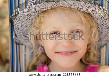 beautiful smiling blond little girl with hat portrait - stock photo