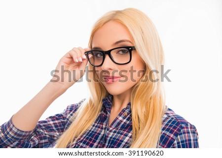 Beautiful smiling blonde touching glasses on white background - stock photo