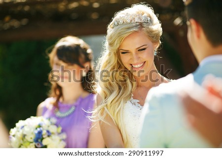 Beautiful smiling bride on wedding ceremony