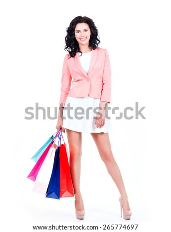 Beautiful smiling brunette woman with shopping bags in casual - isolated on a white background.