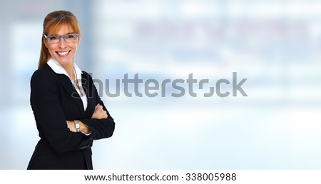 Beautiful smiling business woman. Banking and financial concept. - stock photo