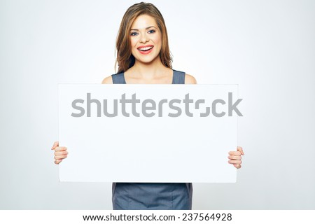 beautiful smiling business woman holding white blank sign board. isolated portrait.