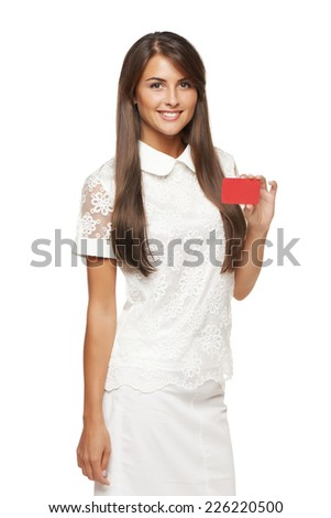 Beautiful smiling business woman showing red card in hand, over white background - stock photo