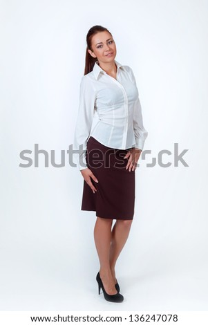 beautiful smiling business woman with long hair on a white background, full length - stock photo