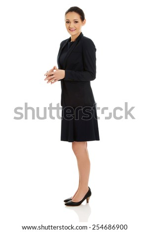 Beautiful smiling businesswoman in formal suit. - stock photo