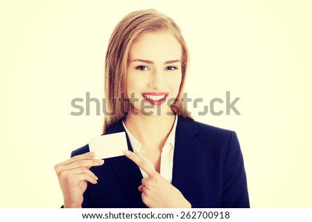 Beautiful smiling businesswoman with business card. - stock photo