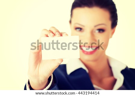 Beautiful smiling businesswoman with businesscard. - stock photo