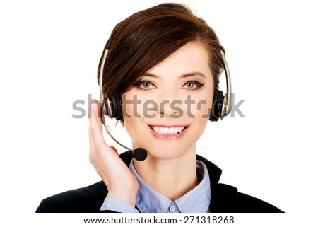 Beautiful smiling call center woman in headset. - stock photo