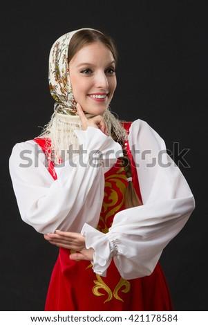 beautiful  smiling caucasian girl in russian folk costume, studio picture - stock photo