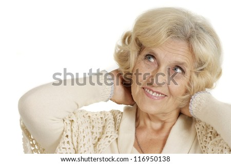 Beautiful smiling charming groomed nice elderly woman on a white background