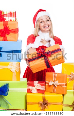 Beautiful smiling Christmas woman giving presents, isolated on white background. - stock photo