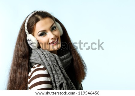 beautiful smiling christmas woman, winter girl over blue background - stock photo