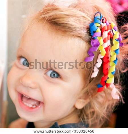 Beautiful smiling cute baby girl. Face close-up, soft focus - stock photo