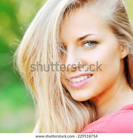 Beautiful smiling girl face - outdoor  - stock photo