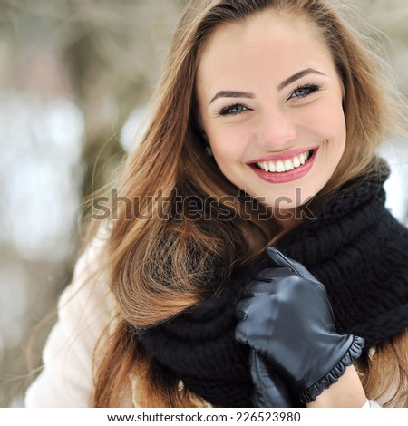Beautiful smiling girl face outdoor winter portrait - stock photo