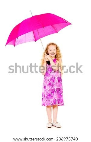 Beautiful smiling girl in a pink summer dress posing with a big pink umbrella. Isolated over white. - stock photo