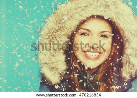 Beautiful smiling girl in snow