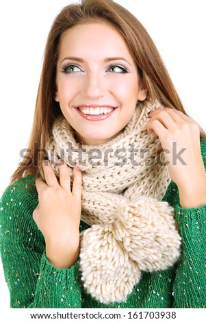 Beautiful smiling girl in warm knit scarf isolated on white - stock photo