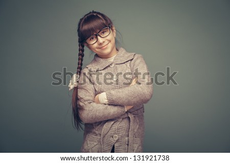 Beautiful smiling girl on a green background. - stock photo