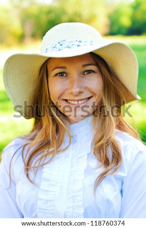 Beautiful smiling girl on summer day