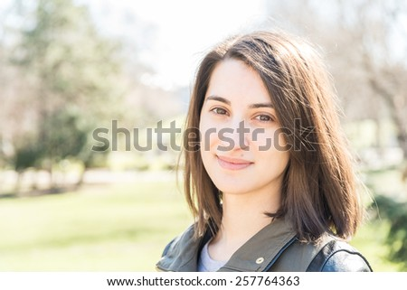 Beautiful Smiling Girl Portrait In Autumn Park