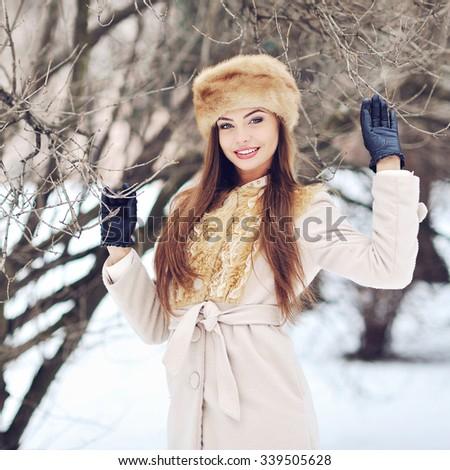 Beautiful smiling girl portrait in winter - stock photo