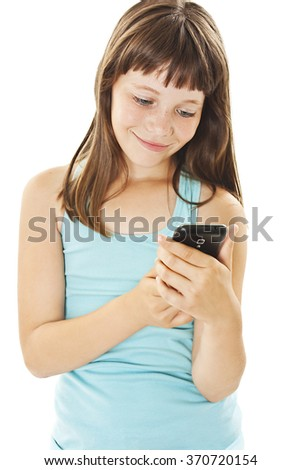 Beautiful smiling girl reading sms on your cell phone. Isolated on white background