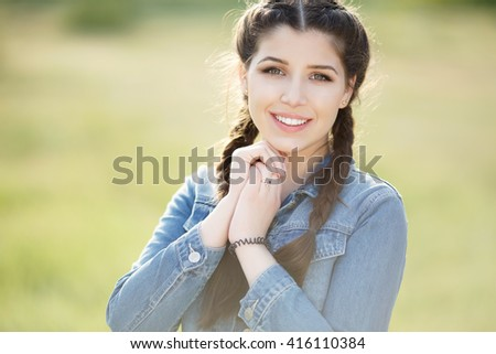 Beautiful smiling girl teenager portrait, happy young female outdoors summertime. Close-up of pretty model posing indoor. - stock photo