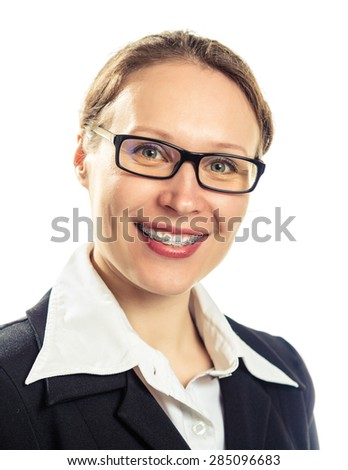 Beautiful smiling girl wearing braces on a white background.