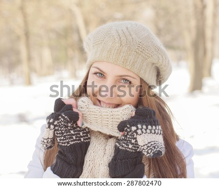 Beautiful Smiling Girl Winter in the park.Caucasian female winter portrait outdoor. - stock photo