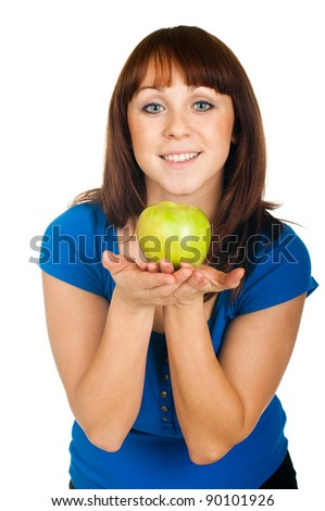 Beautiful smiling girl with apple on white background - stock photo