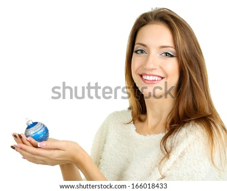 Beautiful smiling girl with Christmas toy isolated on white