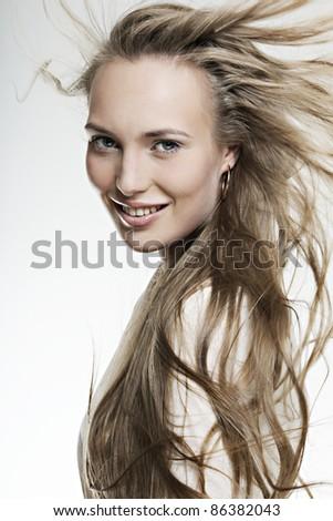 beautiful smiling girl with long wonderful hair - stock photo