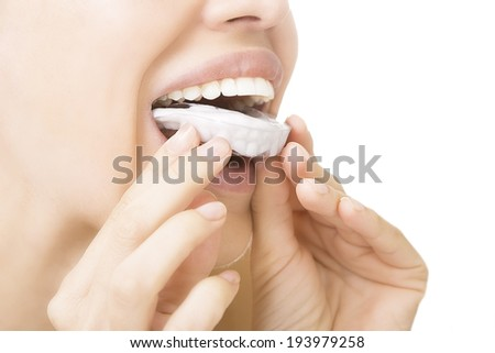Beautiful smiling girl with tooth tray (hands holding individual tooth tray) - stock photo