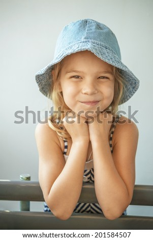 Beautiful smiling little girl in cap