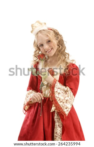 Beautiful smiling little girl with long blonde hair in the princess costume standing with red rose at the white background. Red and gold empire dress - stock photo
