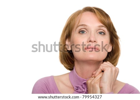 Beautiful smiling middle aged woman looking to the camera. - stock photo