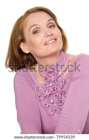 Beautiful smiling middle-aged woman looking to the camera. - stock photo