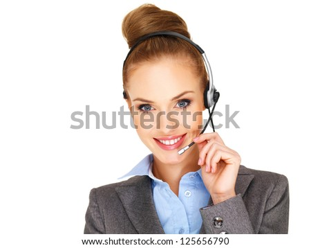 Beautiful smiling receptionist, call centre operator or secretary with her blonde hair in a bun wearing a headset and microphone isolated on white