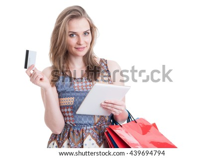 Beautiful smiling shopper holding tablet and credit or debit card doing shopping online isolated on white with copy space - stock photo