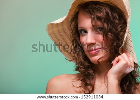 Beautiful smiling spring or summer woman in hat. Green concept