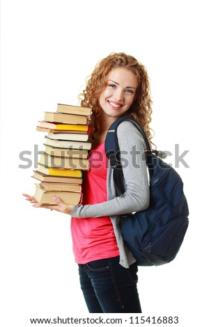 beautiful smiling student girl holding pile of books