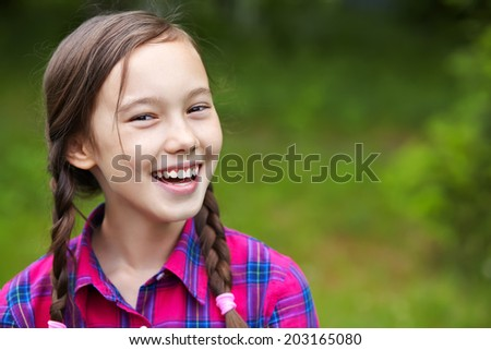 Beautiful smiling teenage girl in a summer park. youth lifestyle